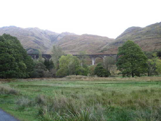 Photo of Glenfinnan viaduct, distant view with hills to the North.