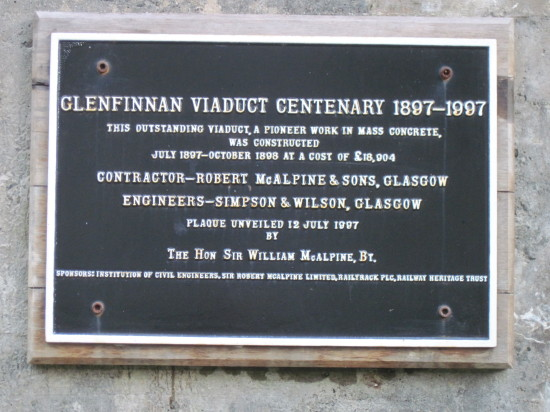 Photo of Glenfinnan viaduct, plaque on an arch celebrating the viaduct's centenary.
