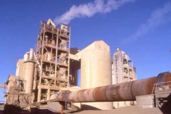 view of cement kiln showing kiln and preheater tower