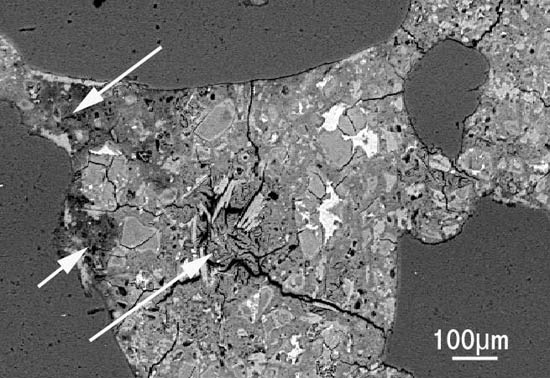 SEM image of sulfate attack in concrete, showing ettringite replacing calcium silicate hydrate.